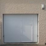 Porte à panneaux portillon intégré